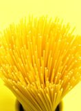 Spaghetti. On yellow Royalty Free Stock Images