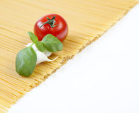 Spaghetti. Mediterranean cooking with pasta and ingredients royalty free stock photography