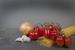 Spaghetti. Mediterranean cooking with pasta and ingredients royalty free stock photos