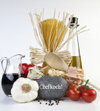 Spaghetti. Mediterranean cooking with pasta and ingredients royalty free stock photo