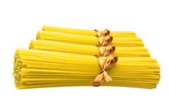 Spaghetti. Yellow spaghetti on a white background close-up royalty free stock images