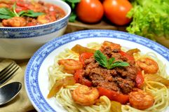 Spaghetti. Plate of spaghetti with beef and shrimp on tomato sauce Stock Photos