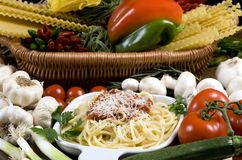 Spaghetti 4. Fresh spaghetti and sauce, surrounded by all the ingredients Stock Photography