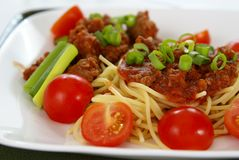 Spaghetti. Italian spaghetti with Meat, tomato sauce, fresh tomatoes and onions Stock Images