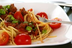 Spaghetti. Italian spaghetti with Meat, tomato sauce, fresh tomatoes and onions Royalty Free Stock Photography