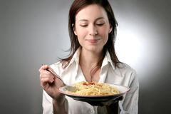Spaghetti. A young woman with a plate of pasta Stock Image