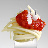 Spaghetti. Tomato and parmesan on a fork Royalty Free Stock Photos