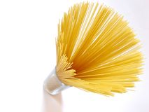 Spaghetti. Uncooked spaghetti in a glass, isolated Royalty Free Stock Photos