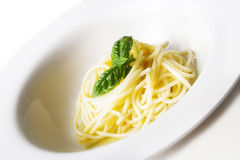 Spaghetti. Simple spaghetti with oil and basil leaf Royalty Free Stock Photography