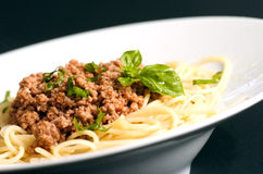 Spaghetti. Bolognese in white plate  on black background Stock Images