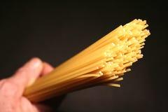 Spaghetti. Closeup on a black background royalty free stock image