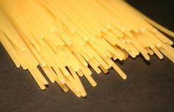 Spaghetti. Closeup on a black background royalty free stock photography