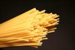 Spaghetti. Closeup on a black background stock photos