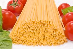 Spaghetti. With tomato and basil on a white background Royalty Free Stock Photography
