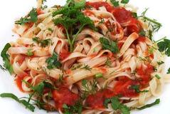 Spaghetti. Serve on plate with tomato Stock Photos