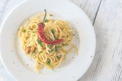 Spaghetti aglio olio e peperoncino. Portion of spaghetti aglio olio e peperoncino: top view Stock Photo