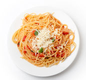 Spaghetti al pomodoro from above. Spaghetti al pomodoro, one of the simplest Italian rustic dishes with the pasta tossed in a sauce of tomato, basil, garlic and Royalty Free Stock Photo