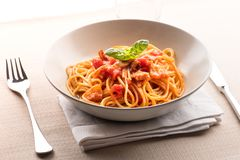 Spaghetti all` amatriciana from the Lazio region. Of Italy with pecorino cheese, pepper, tomato, cured pork jowl or guanciale served in a bowl as a first course royalty free stock photography