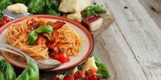 Spaghetti alla amatriciana. On a wooden table close up stock photos