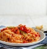 Spaghetti alla amatriciana. On a wooden table close up stock photography