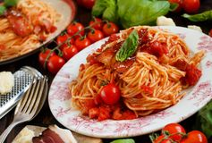 Spaghetti alla amatriciana. On a wooden table close up royalty free stock image