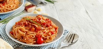 Spaghetti alla amatriciana. On a wooden table close up stock images