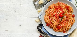 Spaghetti alla amatriciana. On a wooden table top view royalty free stock photo