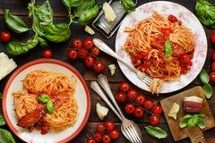 Spaghetti alla amatriciana. On a wooden table top view stock photo