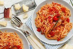 Spaghetti alla amatriciana. On a wooden table top view stock image