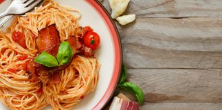 Spaghetti alla amatriciana. On a wooden table top view royalty free stock image