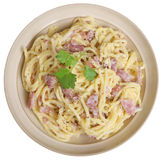 Spaghetti alla Carbonara in Bowl Isolated. Spaghetti all carbonara in beige pasta bowl Royalty Free Stock Images