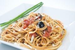 Spaghetti alla puttanesca. An italian recipe royalty free stock images