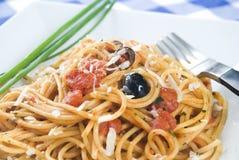 Spaghetti alla puttanesca. An italian recipe stock photo
