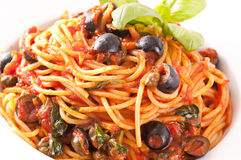Spaghetti alla Puttanesca. With black olives royalty free stock photos