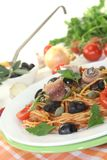 Spaghetti alla puttanesca with anchovies Stock Photo