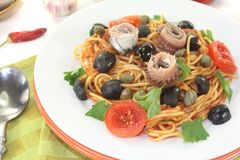 Spaghetti alla puttanesca with anchovy Royalty Free Stock Photo