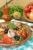 Spaghetti alla puttanesca with anchovy and tomatoes Stock Photo