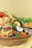 Spaghetti alla puttanesca with capers and anchovies Stock Image
