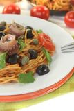 Spaghetti alla puttanesca with capers and anchovies Stock Photography