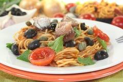 Spaghetti alla puttanesca with capers Stock Images