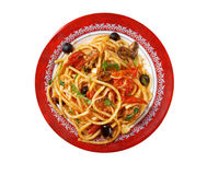 Spaghetti alla puttanesca. Salty Italian pasta dish.ingredients are typical of Southern Italian cuisine: tomatoes, olive oil, olives, capers and garlic royalty free stock images