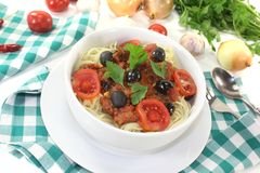 Spaghetti alla puttanesca with tomatoes Stock Photos