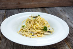 Spaghetti alla vongole on a wooden background Royalty Free Stock Photo