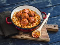 Spaghetti And Meatballs In Tomato Sauce On Wooden Rustic Board. Royalty Free Stock Photos
