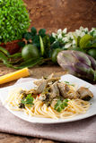 Spaghetti with artichokes and parsley Stock Images