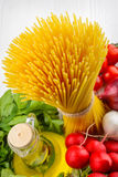 Spaghetti and assorted grocery products Stock Photos