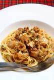 Spaghetti avec du porc Images stock