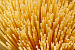 Spaghetti background. Abstract spaghetti background of raw uncooked pasta Royalty Free Stock Photo
