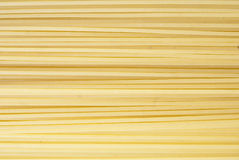 Spaghetti background. Yellow raw spaghetti full frame background Royalty Free Stock Images