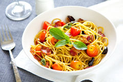 Spaghetti with bacon and dried chilli Stock Photo